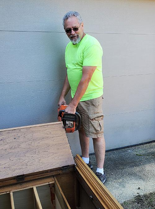 man removing furniture